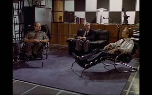 Fraiser, a couples counsellor, and Niles site in a room with leather recliners and a black and white wall.