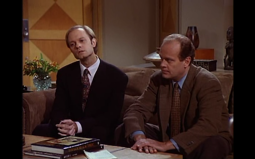 Niles and Frasier sit on Frasier's couch